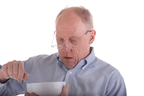 older man eating cereal